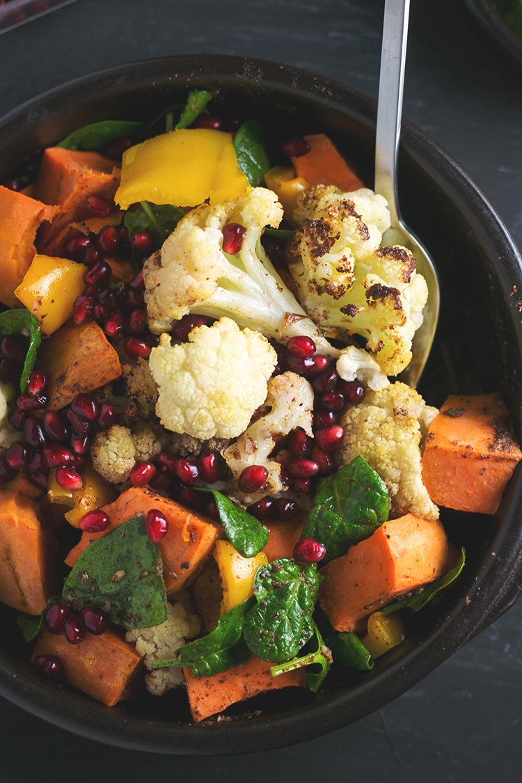 Roasted Cauliflower and Sweet Potato Salad with Cumin Sumac Dressing #sumac #cumin #cauliflower #sweetpotato #vegan #salad #healthy #pomegranate #rainbow #lowfat
