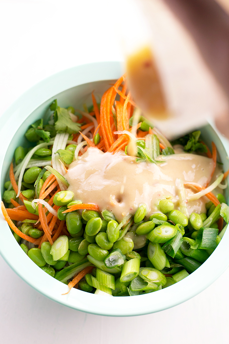 Japanese inspired Soba Noodles with edamame, carrot and cucumber - tossed in a delicious Miso Tahini Dressing. Vegan and Gluten Free. #vegan #japanese #asian #soba #healthy #foodporn #tahini #ginger #noodles